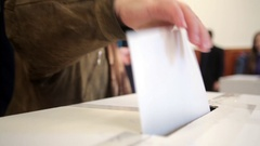Person voting at polling station Stock Footage