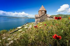 On the brink of rescue. Monastery on the lake. Armenia Stock Photos