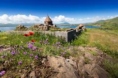 The old monastery in mountains over the lake. Monastery near the lake in Armenia Stock Photos