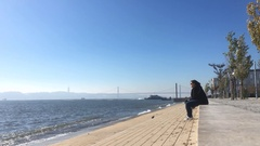 Sitting By Tagus River In Lisbon On A Sunny Day, Portugal Stock Footage