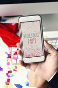 Text holiday party in a smartphone Stock Photos