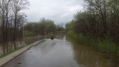 Flooded road aerial Stock Footage