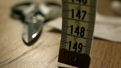 Super slow motion video of falling tailor measure tape. Handmade, tailoring Stock Footage