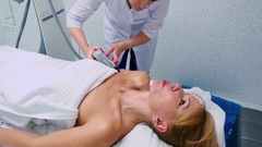 Vacuum massage on shoulder in the beauty clinic Stock Footage