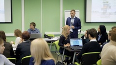 Lecturer in classroom at the university speaking the lecture for group of Stock Footage