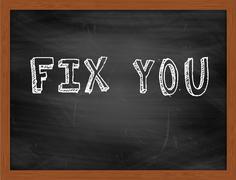 FIX YOU  hand writing text on black chalkboard Stock Illustration