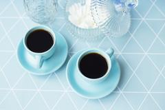 A beautiful arrangement of delicious coffee on a napkin geometric Stock Photos