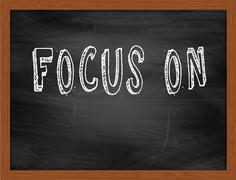 FOCUS ON  hand writing text on black chalkboard Stock Illustration