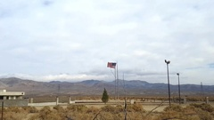 USA flag waving on a oil field, near Death valley, California, in United st.. Stock Footage