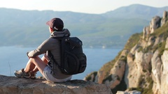 Young smiling tourist enjoying beautiful view in the mountain HD Stock Footage