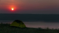 4k.Mountain lake and  traveller tent in sunrise. Time lapse  without birds.  Stock Footage