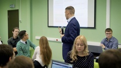 Lecturer speaks to students at a lecture on economics. Students in the large Stock Footage
