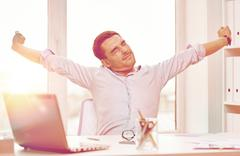 Bored businessman with laptop and papers at office Stock Photos