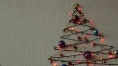 Multi-colored flashing lights and Christmas tree balls on the wall in the form Stock Footage