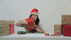 Asian prepares gifts for celebration of Christmas, New Year Stock Footage