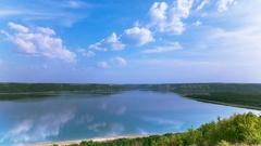 4k.Sea or lake  and clouds reflection  . Timelapse  without birds. RAW output Stock Footage