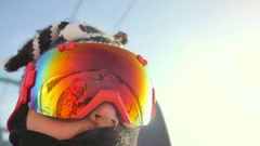 Skier in glasses skiing downhill in high mountains on ski lift during sunny day Stock Footage