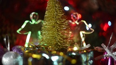 New Year composition of an angel and gold Christmas trees. Stock Footage
