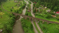 Aerial drone view old bridge (aqueduct) under river and road Stock Footage