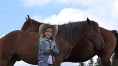 4K Child with Horses Animals on Meadow, Happy Cowboy Girl Playing and Pasturing Stock Footage
