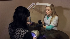 Manicure. Master makes nail extension and drawing of the layer of gel. Stock Footage