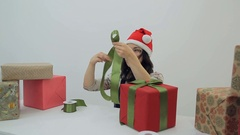 Asian brunette woman makes bow to decorate new year present box Stock Footage