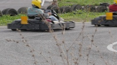 People driving karts on a kart track slow motion Stock Footage