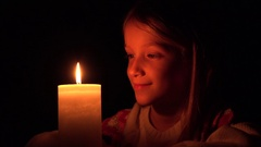 4K Happy Child with Candle, Prayer Girl in Night, Kid Portrait, Face in Dark Stock Footage