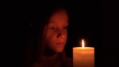 4K Sad Child with Candle, Pensive Girl in Night, Prayer Kid Portrait View, Face Stock Footage