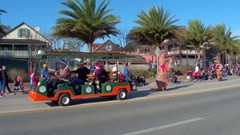 Dinosaurs dancing in the St Augustine winter Parade Stock Footage