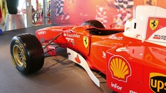 A red and white racecar in Abu Dhabi. Pan shot. Stock Footage