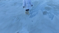 Girl child leaves the frozen lake. The child goes home with disappointment. Stock Footage