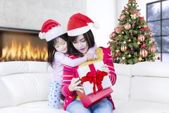 Asian mother and child open christmas gift Stock Photos