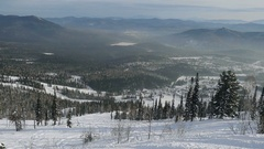 Winter mountains panorama with ski slopes and ski lifts in Sheregesh in slow Stock Footage