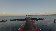 Flying over the wooden pier in water Stock Footage