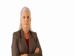 A professional businesswoman poses for a portrait on a white background Stock Footage