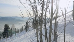 Winter mountains panorama with ski slopes through the sun in Sheregesh in slow Stock Footage