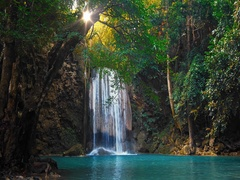 Waterfall flowing in green tropical forest. Beautiful nature of Thailand jungle Stock Footage