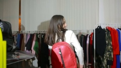 Young woman choosing bag in the shop. Stock Footage