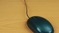 The man operates a computer mouse. Stock Footage