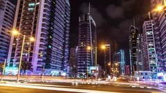 Dubai night street full of skyscrappers. Time lapse. Stock Footage
