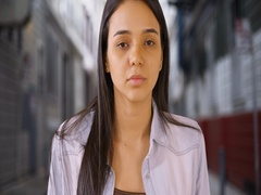 A young girl dramatically stares into the camera Stock Footage
