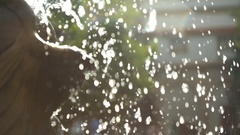 Clean and clear water shimmers down the fountain Stock Footage