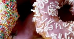 Close-up of tasty doughnuts with sprinkles Stock Footage