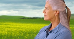 An older woman takes in the sights in the prairies Stock Footage