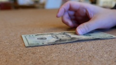 People counting US dollars at a bank counter inside TD bank Stock Footage