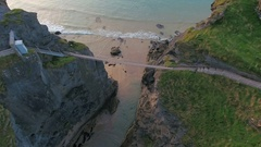 Aerial view of the Carrick-a-Rede Rope Bridge in Ireland Stock Footage