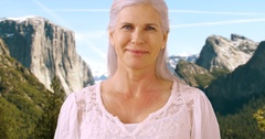 An older woman takes in the sights in the mountains Stock Footage