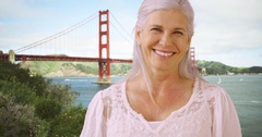 An older woman takes in the sights in the Golden Gate Bridge Stock Footage