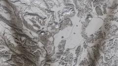 High-altitude overflight aerial of frozen tundra, Russia's Kamchatka Peninsula Stock Footage